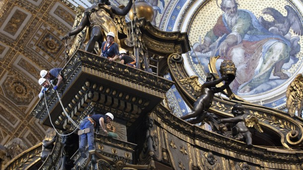 VATICAN WORKER DUSTS BALDACCHINO IN ST. PETER'S BASILICA