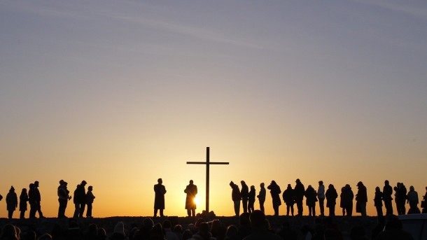Sun rises as people gather for ecumenical Easter service in Massachusetts