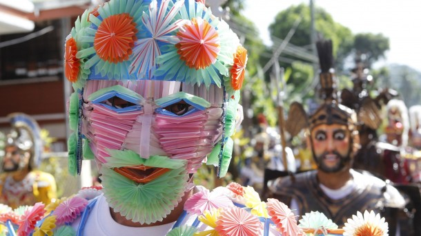 PENITENT WEARS COLORFUL MASK DURING HOLY WEEK CELEBRATION IN PHILIPPINES