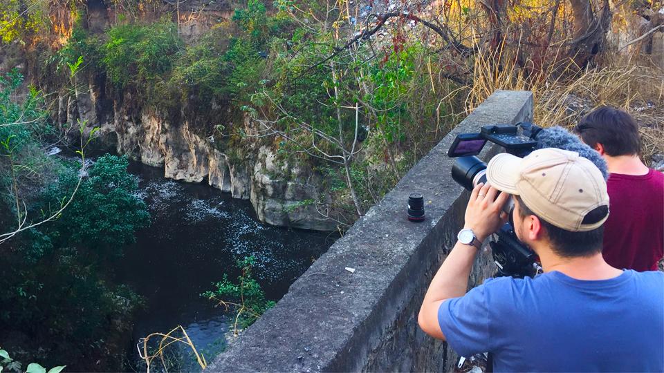 The crew of The Francis Impact film a river in El Salvador