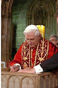 Pope Benedict signing a document