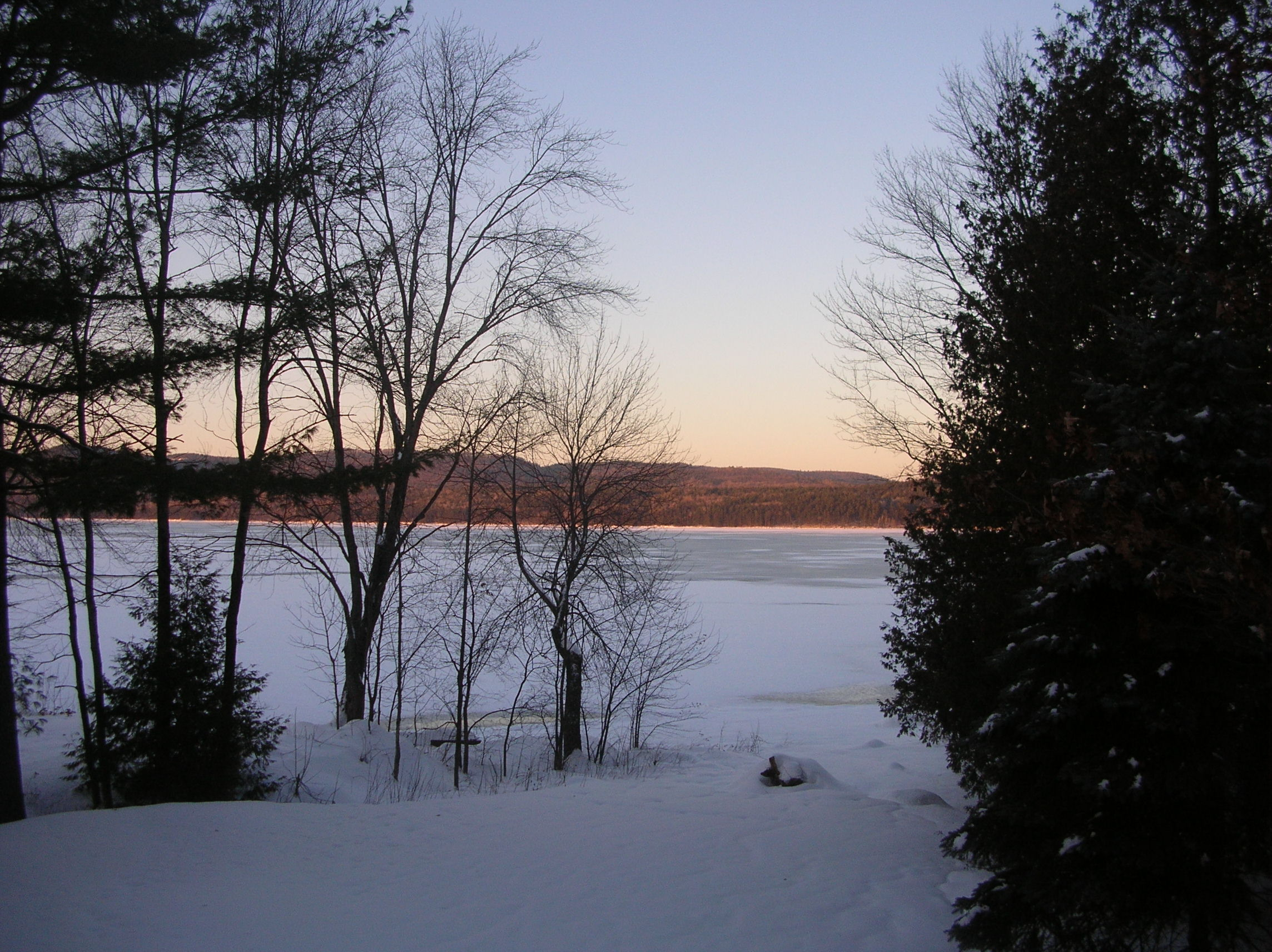 The Dmytrenko backyard, overlooking the frozen-over Ottawa River and Quebec's Laurentian mountains.