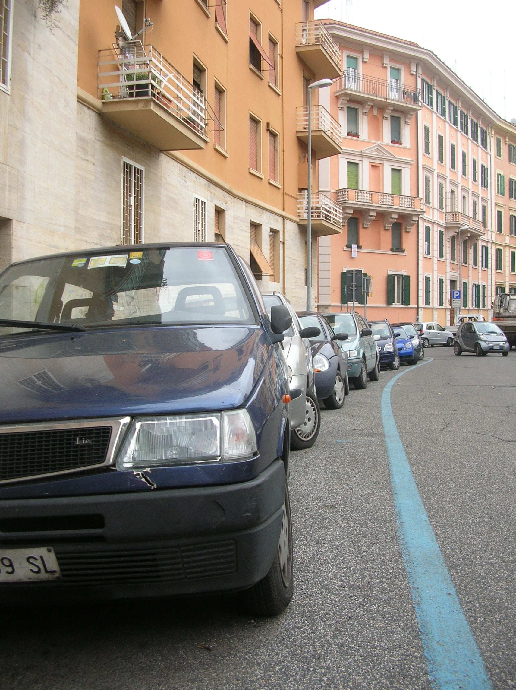 Small cars squeeze extra inches from Rome's limited parking