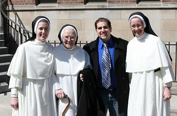 S+L editor Richard Valenti flanked by three Dominican Sisters of St. Cecilia