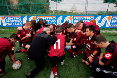 PRIESTS AND SEMINARIANS PRAY BEFORE START OF SOCCER MATCH
