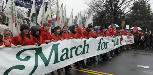 YOUNG PEOPLE WALK WITH BANNER AT START OF MARCH FOR LIFE IN WASHINGTON