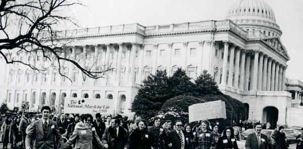 People walk past U.S. Capitol during second March for Life in Washington