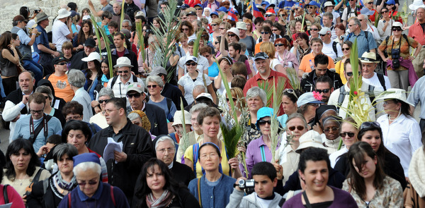 Christian pilgrims carry palm branches during Palm Sunday procession in 2012 in Jerusalem