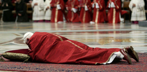 POPE LIES ON FLOOR DURING GOOD FRIDAY SERVICE