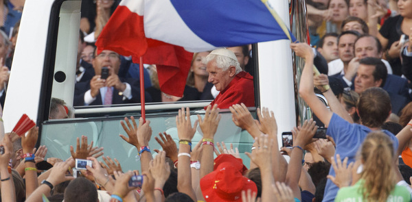Young people wave as Pope Benedict departs World Youth day celebration in 2011 in Spain