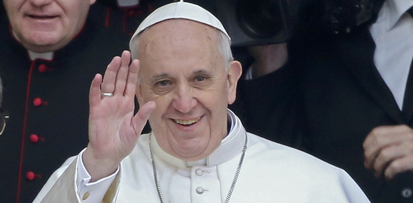 Newly-elected Pope Francis waves after praying at basilica in Rome