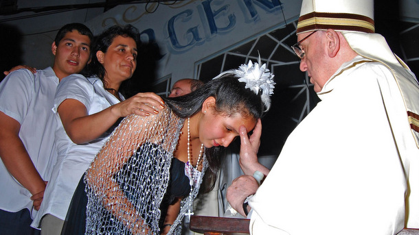 Argentine Cardinal Jorge Mario Bergoglio confirms young woman at church in Archdiocese of Buenos Aires in 2012