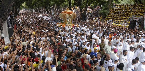 PILGRIMS RAISE HANDS DURING ANNUAL PROCESSION IN BRAZIL