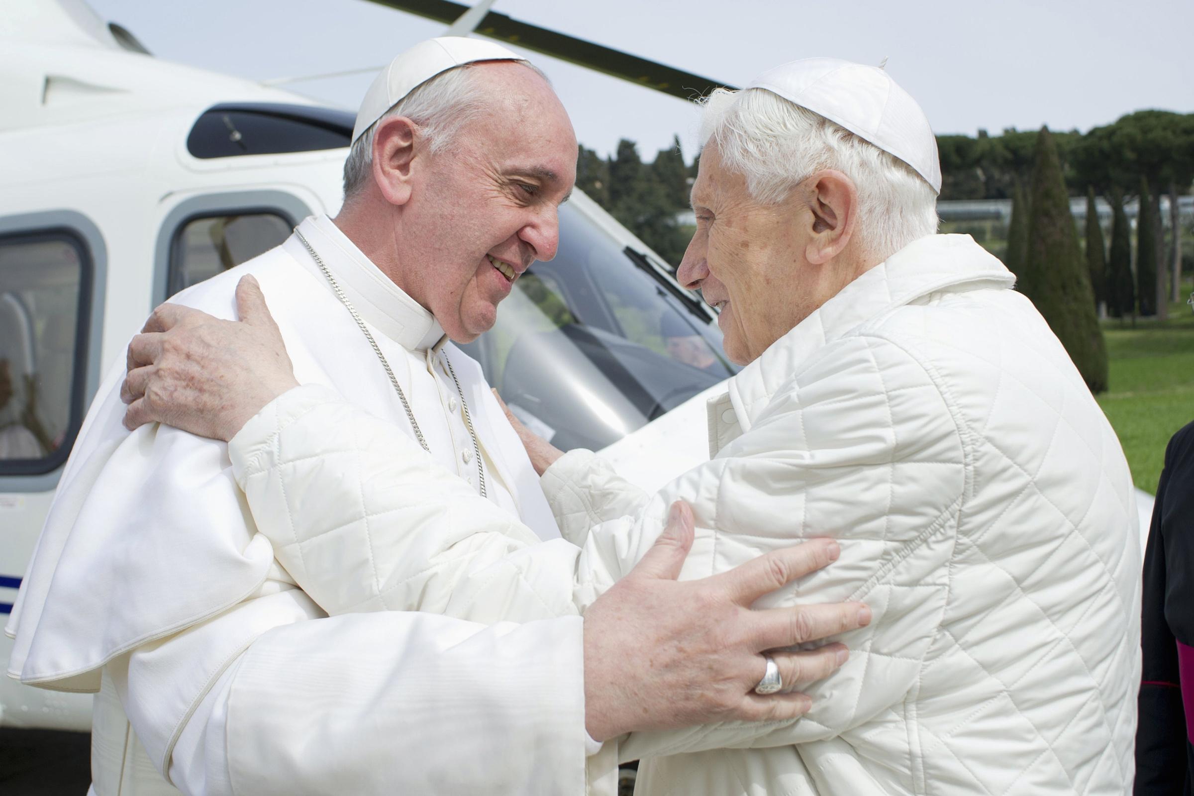 Pope Francis embraces emeritus Pope Benedict XVI at papal summer residence in Castel Gandolfo