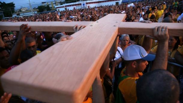 Cross in slum cropped