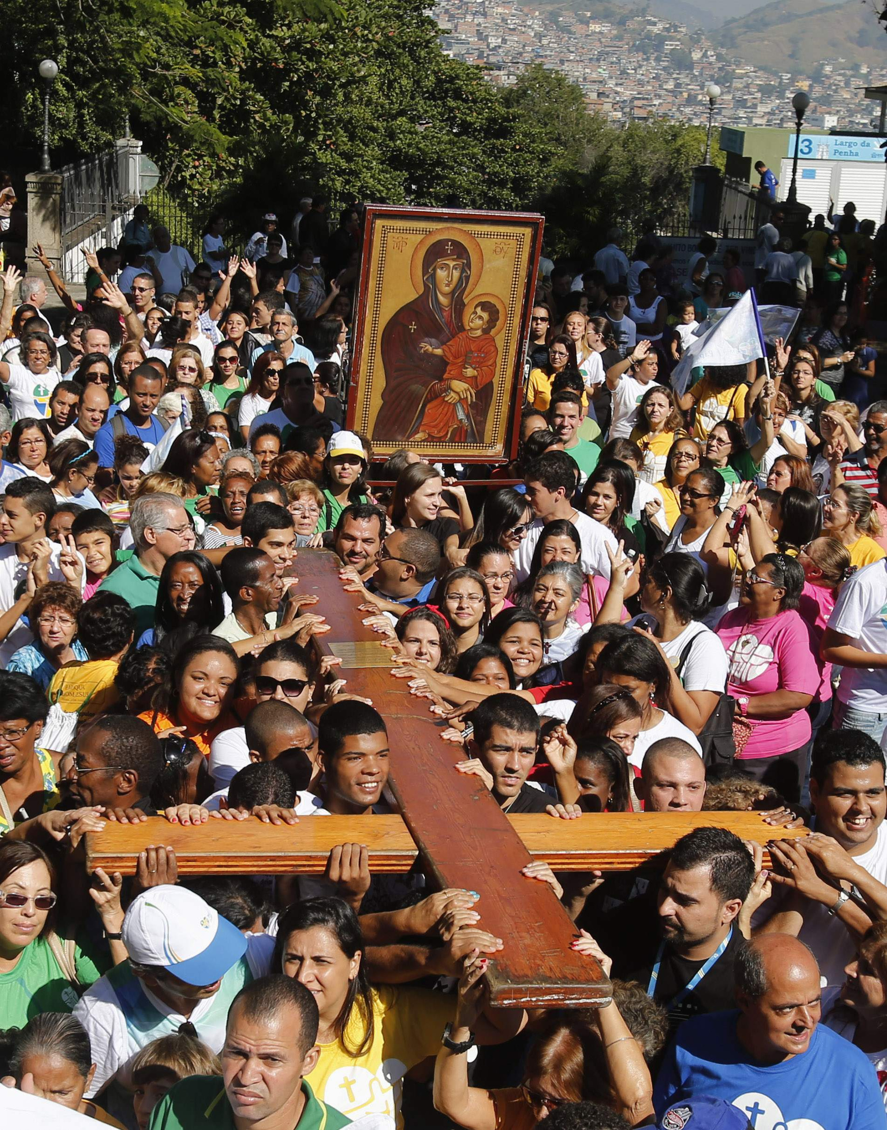 Young people carry World Youth Day cross during visit to Sanctuary of Our Lady of Penha in Rio de Janeiro