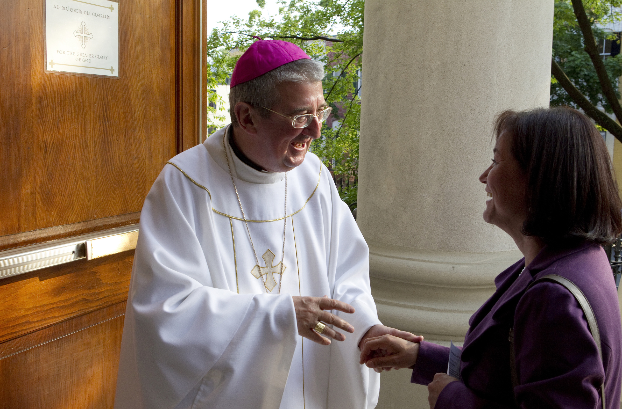 ARCHBISHOP MARTIN OF DUBLIN GREETS WOMAN OUTSIDE WASHINGTON CHURCH
