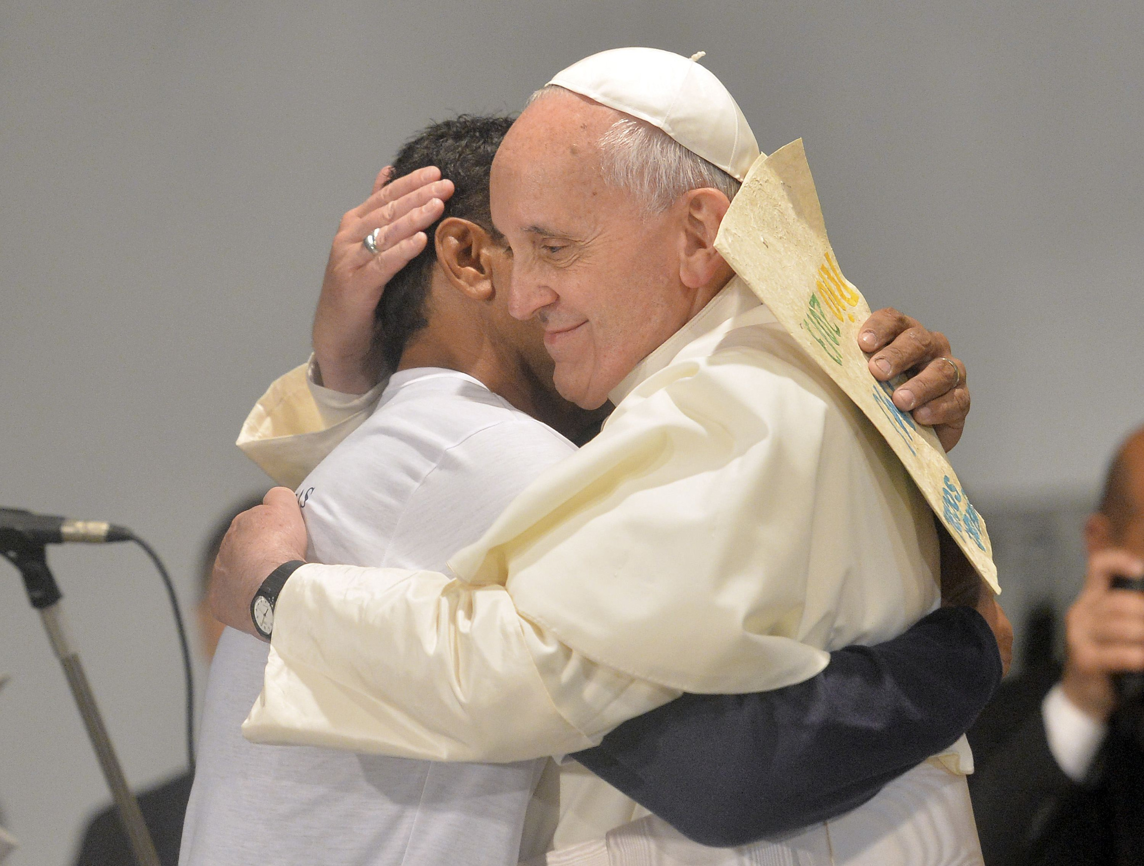 Pope Francis embraces a patient at St. Francis of Assisi Hospital in Rio de Janeiro