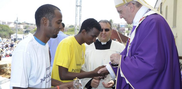 Pope accepts offertory gifts as he celebrates Mass in port of Lampedusa