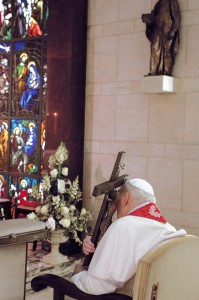 FILE PHOTO OF POPE JOHN PAUL II EMBRACING CRUCIFIX ON GOOD FRIDAY IN 2005