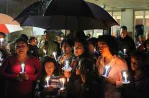 People hold candles during Rhode Island prayer vigil for immigration reform
