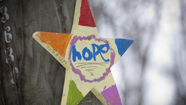 Star painted with word hope seen on poll in Newtown, Conn.