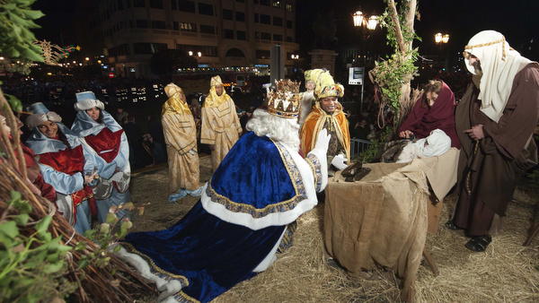 MEN DRESSED AS 'THREE WISE MEN' PRESENT GIFTS TO BABY DURING ANNUAL EPIPHANY PARADE IN SPAIN