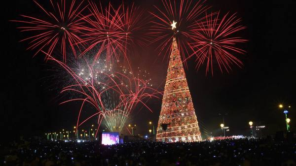 FIREWORKS LIGHT UP SKY NEAR GIANT CHRISTMAS TREE IN PHILIPPINES