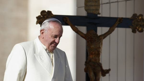 Pope passes crucifix during general audience in St. Peter's Square at Vatican