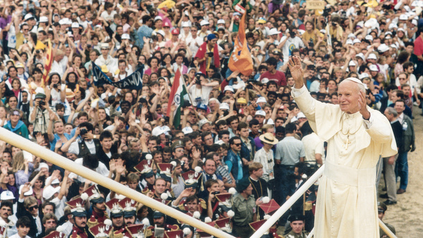 1992 photo of Blessed John Paul II greeting crowd at World Youth Day in Poland