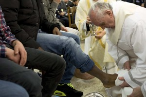 Pope Francis washes the foot of a prisoner at Casal del Marmo youth prison in Rome