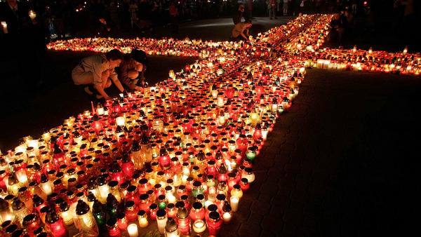 PEOPLE LIGHT CANDLES IN MEMORY OF POPE JOHN PAUL II