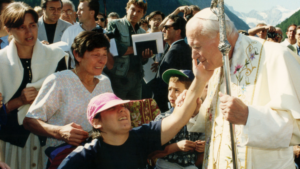 POPE JOHN PAUL II GREETS YOUNG PERSON DURING 1994 VACATION IN ITALY