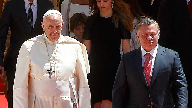 Pope Francis is welcomed by Jordan's King Abdullah II after arriving in Amman May 24.