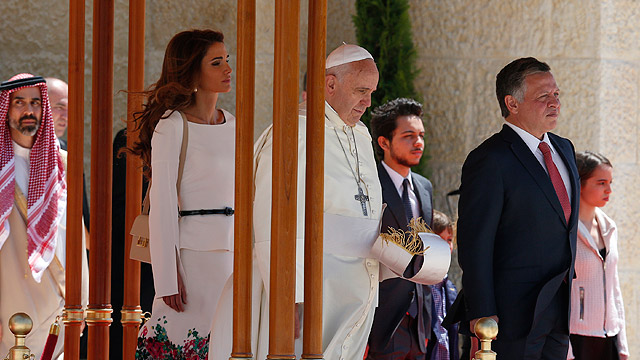 Pope Francis is welcomed by Jordan's King Abdullah II and his wife, Queen Rania, during an arrival ceremony at the al-Husseini Royal Palace in Amman May 24. The pope is making a three-day visit to the Holy Land, spending one day each in Jordan, the Pales tinian territories and Israel. (CNS photo/Paul Haring)