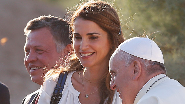 Jordan's King Abdullah II and his wife, Queen Rania, arrive with Pope Francis as the pontiff visits Bethany Beyond the Jordan May 24, believed to be where Jesus was baptized, southwest of Amman. (CNS photo/Paul Haring)