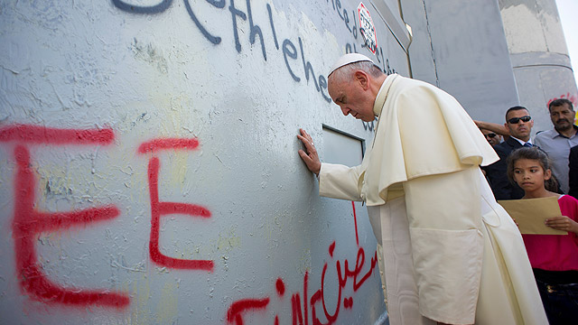 Pope Francis prays in front of the Israeli security wall in Bethlehem, West Bank, May 25. (CNS photo/L'Osservatore Romano, pool)