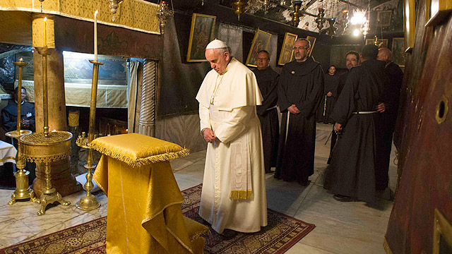 Pope Francis prays in the Church of the Nativity in Bethlehem, West Bank, May 25, the traditional site of Christ's birth. (CNS photo/L'Osservatore Romano via Reuters)