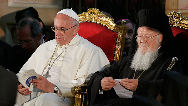 Pope Francis and Ecumenical Patriarch Bartholomew of Constantinople attend an ecumenical celebration in the Church of the Holy Sepulcher in Jerusalem May 25. (CNS photo/Paul Haring)