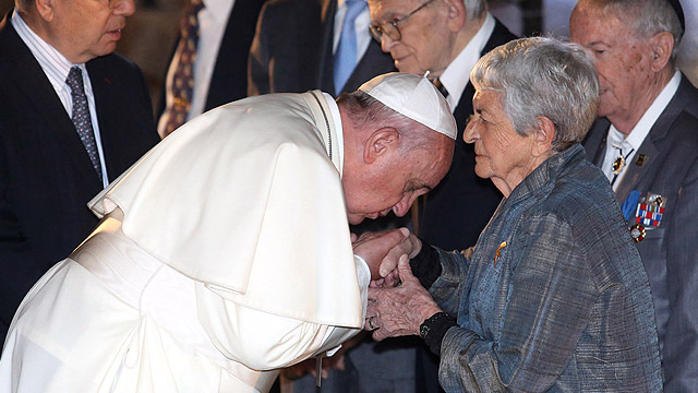 Pope Francis kisses the hand of a woman during a ceremony in the Hall of Remembrance at the Yad Vashem Holocaust memorial in Jerusalem May 26. The pope honored the 6 million Jews who perished at the hands of the Nazis during the Holocaust. (CNS photo/Abi r Sultan, EPA)