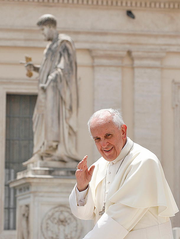 Pope Francis passes the statue of St. Peter