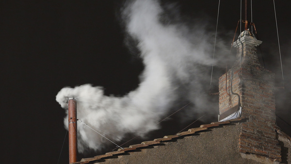 White smoke billows from chimney of Sistine Chapel after cardinals elected new pope