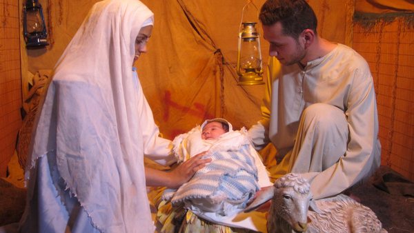 Iraqis re-enact the Nativity at Ainkawa refugee camp near Irbil, Iraq, Dec. 19. Christmas bells did not ring in Mosul and Christian villages this year for the first time in 1,600 years. (CNS photo/Sahar Mansour) See CHRISTMAS-PATRIARCHS Dec. 26, 2014.