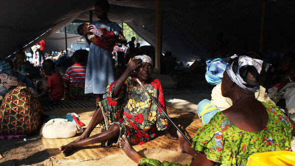 Families displaced by violence take shelter on at the Don Bosco Catholic youth center in Bangui, Central African Republic, Dec. 25, Christmas Day. (CNS photo/Andrea Campeanu, Reuters) (Dec. 26, 2013)