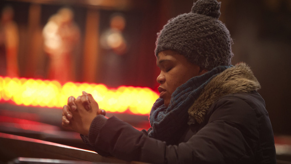 Woman prays on Ash Wednesday at New York church