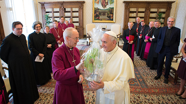 Pope Francis accepts a gift of a fig tree cutting from Anglican Archbishop Justin Welby of Canterbury, spiritual leader of the Anglican Communion, during a private meeting at the Vatican June 16. The cutting is from a tree at Lambeth Palace that was planted in 1556 by Cardinal Reginald Pole, the last Roman Catholic archbishop of Canterbury. (CNS photo/L'Osservatore Romano) (June 25, 2014) See POPE-WELBY June 16, 2014.