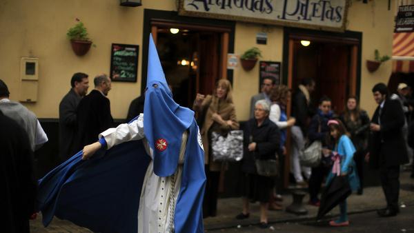 Penitent walks during Holy Week in Spain
