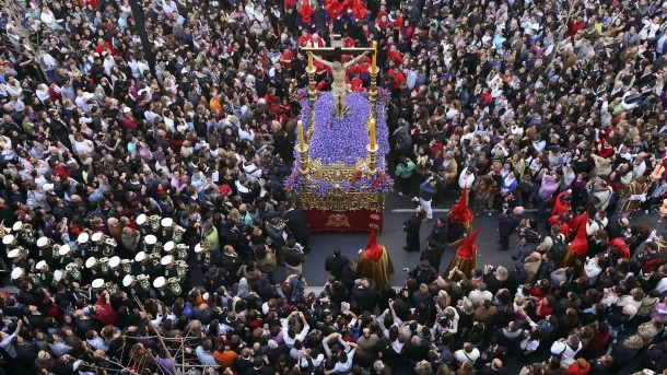 PEOPLE JOIN HOLY WEEK PROCESSION IN SPAIN