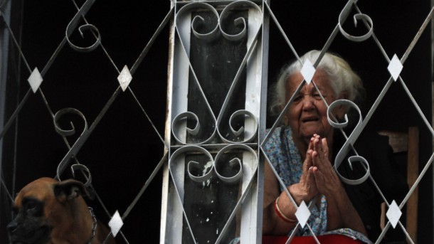 WOMAN REACTS DURING STATIONS OF THE CROSS PROCESSION IN HAVANA