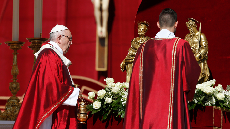 Pope Francis incenses the statues of Saints Peter and Paul